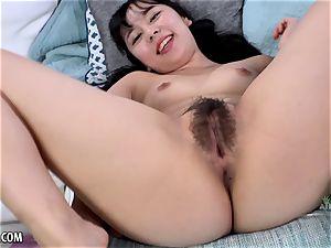 asian stunner jizzes hard on her fucktoy