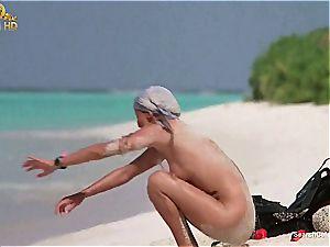 stellar Bo Derek showcasing off her fur covered snatch at the beach