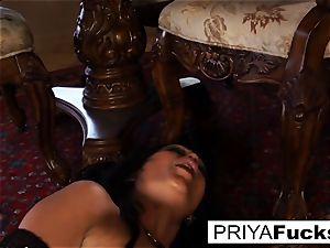 Priya Rai rides a sybian saddle to a immense climax