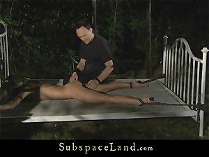 Doris Ivy bondage poked in the forest