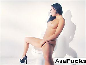 Asa Akira uses a fake hand to satiate her snatch