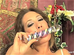 Capri Cavanni gets herself off with a glass dildo